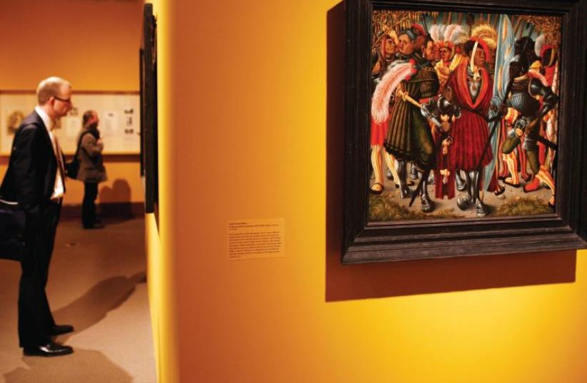 THE PAINTING 'St. Maurice and His Companions of the Theban Legion' by an unknown South German artist is displayed in an exhibition of Old Master paintings entitled 'Reclaimed: Paintings from the Collection of Jacques Goudstikker' at the Jewish Museum in New York, 2009. (photo credit: SHANNON STAPLETON / REUTERS)