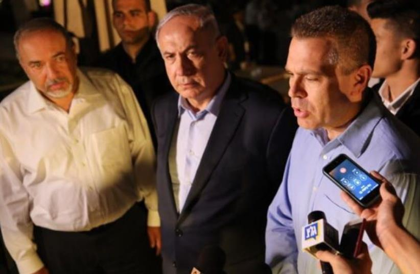 Netanyahu and Liberman at site of Sarona complex shooting in Tel Aviv. (photo credit: Courtesy)