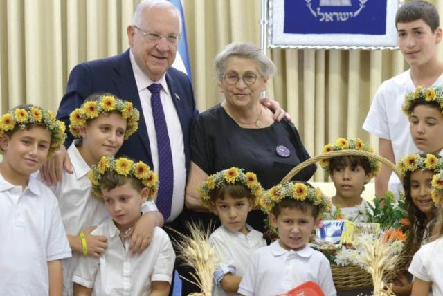 PRESIDENT REUVEN RIVLIN and his wife, Nechama, welcome the children of dairy farmers at the President's Residence in Jerusalem yesterday. (photo credit: Mark Neiman/GPO)