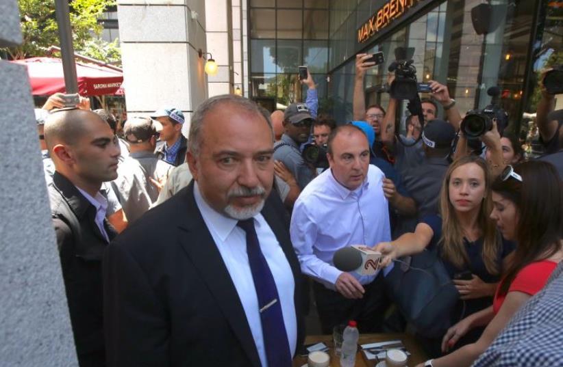Defense Minister Avigdor Liberman visits scene of Tel Aviv terror attack (photo credit: MARC ISRAEL SELLEM/THE JERUSALEM POST)