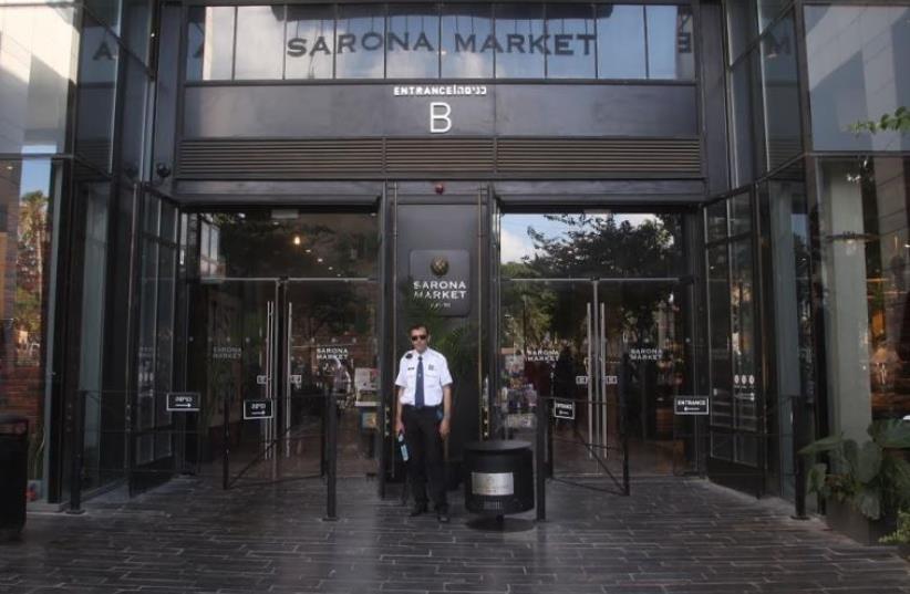 Security gaurd at Tel Aviv's Sarona Market  (photo credit: MARC ISRAEL SELLEM)