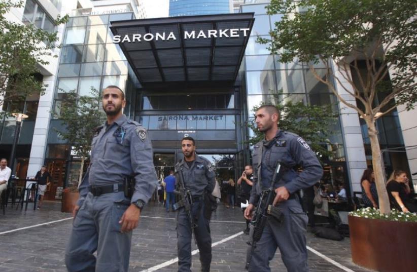 In the aftermath of the deadly shooting, a heavy security presence guards the entrance to Tel Aviv's Sarona Market last week (photo credit: MARC ISRAEL SELLEM)