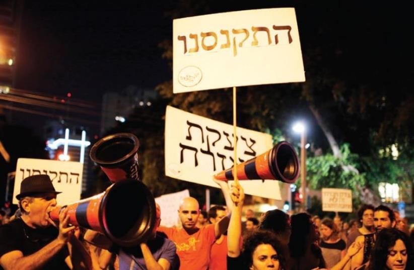 Israelis take part in a demonstration against austerity measures in Tel Aviv in 2013 (photo credit: REUTERS)