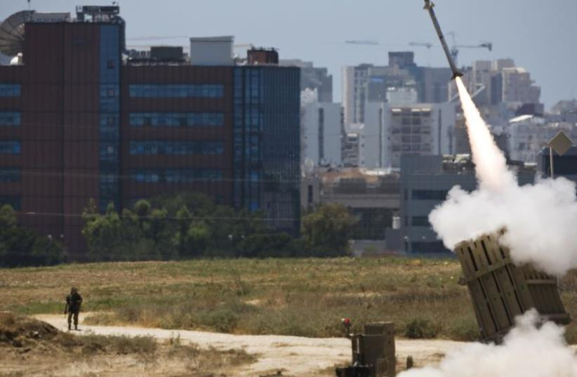 An Iron Dome launcher fires an interceptor rocket in southern Israel (photo credit: REUTERS)
