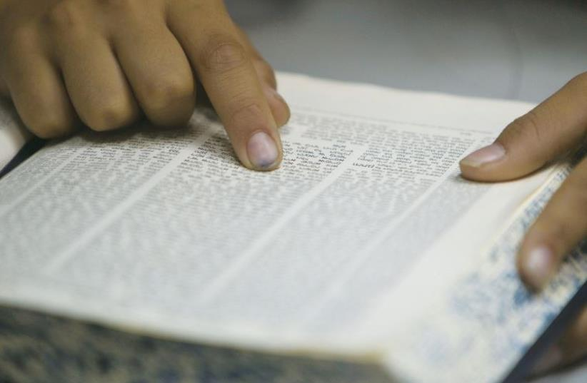 The practice of 'Tikkun Leil Shavuot' is to dedicate one whole night to the study of Torah and discussion (photo credit: REUTERS)