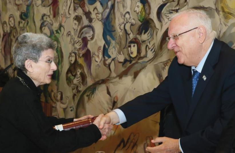 CANADIAN ARCHITECT Phyllis Lambert receiving the 2016 Wolf Prize from President Reuven Rivlin at the Knesset (photo credit: ODED ANTMAN)