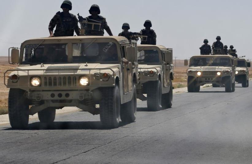 A Jordanian army convoy  (photo credit: REUTERS)