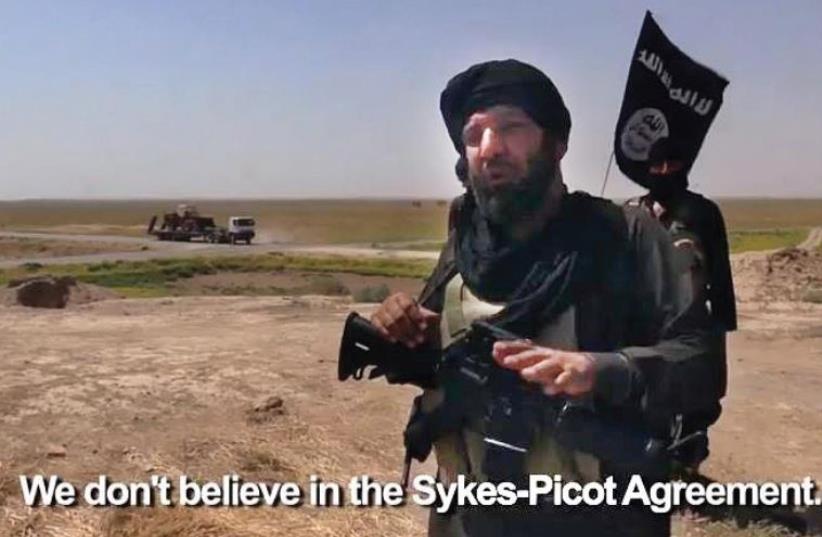 ISIS militant (photo credit: screenshot)
