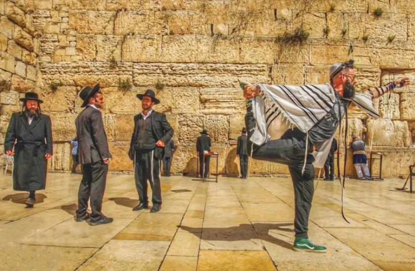 AMERICAN YOGA master Seth Kaufman doing yoga at the Western Wall in Jerusalem. (photo credit: ROBERT STURMAN)