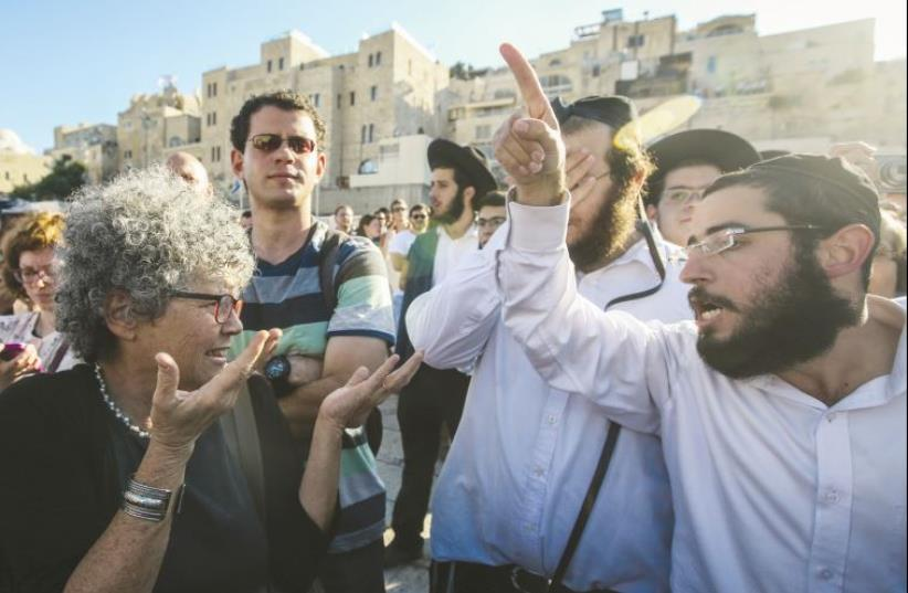 Conflict at the Kotel. Members of the Reform Movement clash with Orthodox worshipers at the Western Wall last week (photo credit: MARC ISRAEL SELLEM)