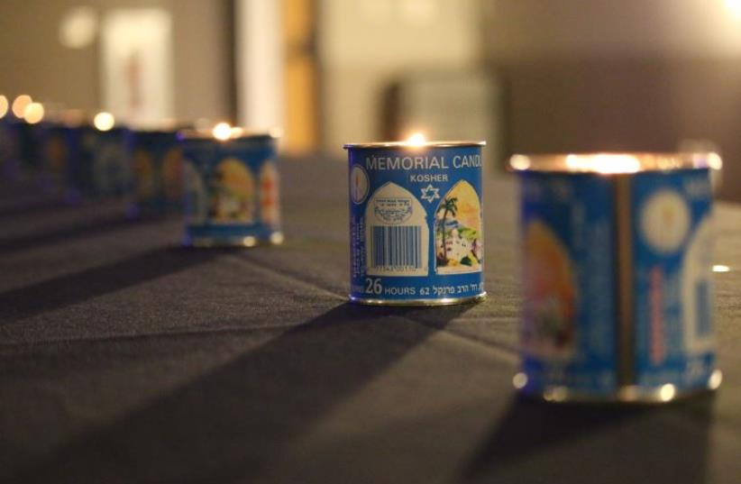 In honor of the Pulse shooting victims, Yizkor candles adorn a table in the Rosen Jewish Community Center in Orlando on Wednesday, June 22. (photo credit: SHANA MEDEL)