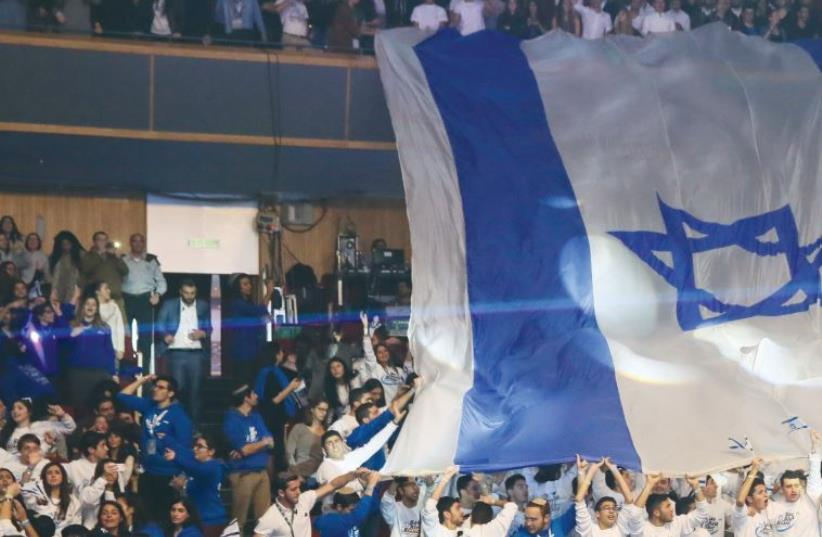 THE ISRAEL EXPERIENCE has attracted thousands of young Jews to its volunteer and internship programs. (photo credit: COURTESY ISRAEL EXPERIENCE)