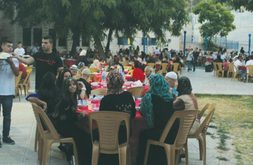 GUESTS ATTEND the Ramadan break-fast charitable event in Abu Gosh, west of the capital, on Friday (photo credit: UDI SHAHAM)