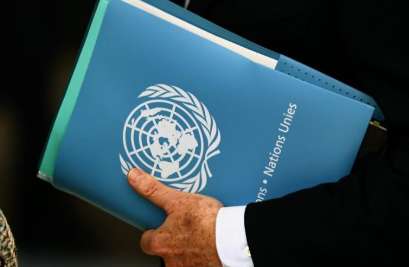 Envoy holds folder at the 31st Session of the Human Rights Council at the U.N. European headquarters in Geneva, Switzerland (photo credit: REUTERS)