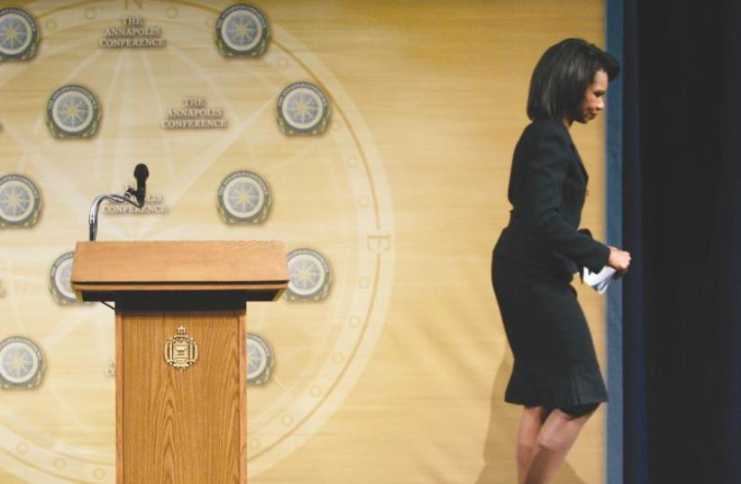 THEN US secretary of state Condoleezza Rice walks off the stage after making closing remarks at the Mideast Peace Conference in Annapolis in 2007 (photo credit: REUTERS)
