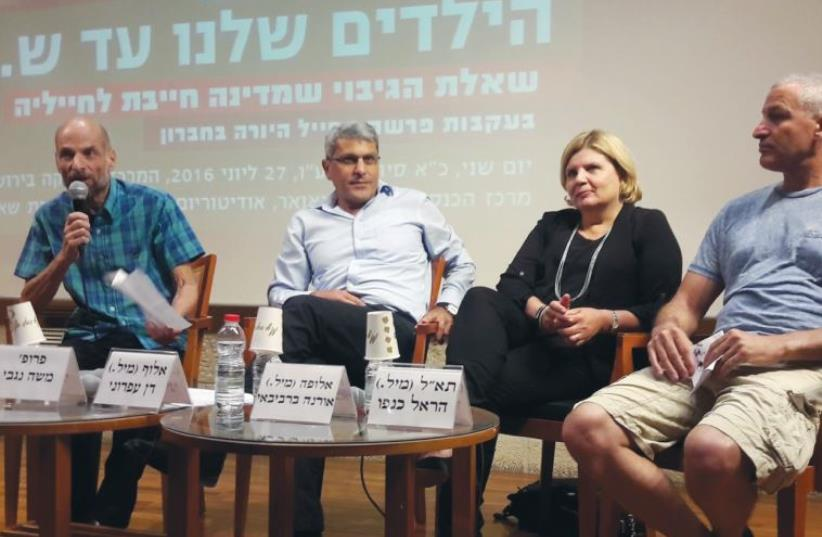 PARTICIPANTS AT THE recent Jerusalem Center for Ethics conference are (l to r) legal commentator Prof. Moshe Negbi, former military advocate-general Maj.-Gen. (res.) Danny Efroni, former maj.-gen. and head of the IDF Manpower Directorate Orna Barbibie, and former brig.-gen. and paratroopers commande (photo credit: YONAH JEREMY BOB)