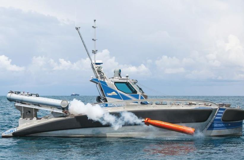 ELBIT'S SEAGULL, seen here in Haifa harbor after its recent initial test, is an unmanned vessel capable of detecting mines and firing torpedoes. ( (photo credit: GALINA KANTOR/ELBIT SYSTEMS)