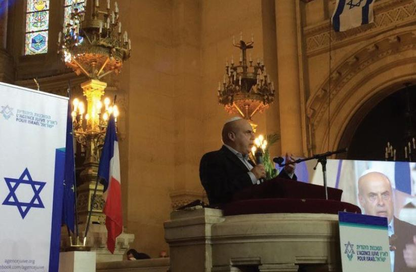 JAFI head Natan Sharansky wishes success yesterday in Paris to French Jews about to make aliya. (photo credit: JAFI)