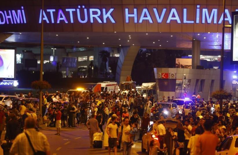 People leave Turkey's largest airport, Istanbul Ataturk, Turkey, following a blast June 28, 2016. (photo credit: REUTERS)