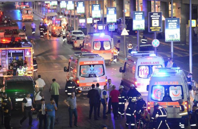 Paramedics help casualties outside Turkey's largest airport, Istanbul Ataturk, Turkey, following a blast, June 28, 2016 (photo credit: REUTERS)