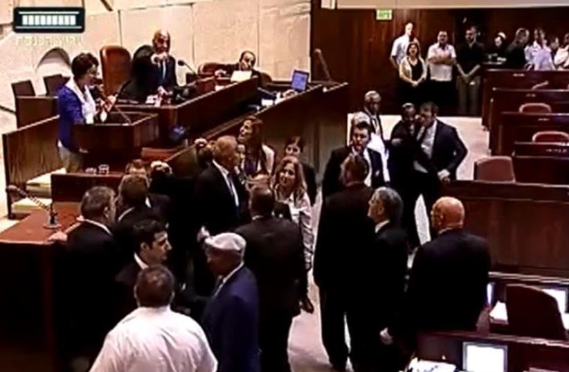 "Knesset brawl erupts after Arab Israeli MK calls IDF soldiers ""murderers,"" June 29, 2016 (photo credit: SCREENSHOT KNESSET CHANNEL)"