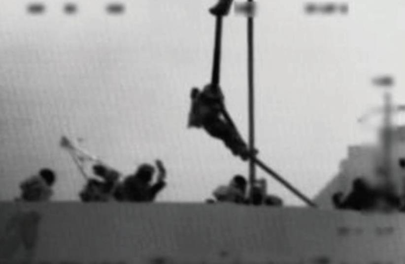 AN IDF soldier rappels onto the Mavi Marmara during the Navy raid in 2010. (photo credit: IDF)