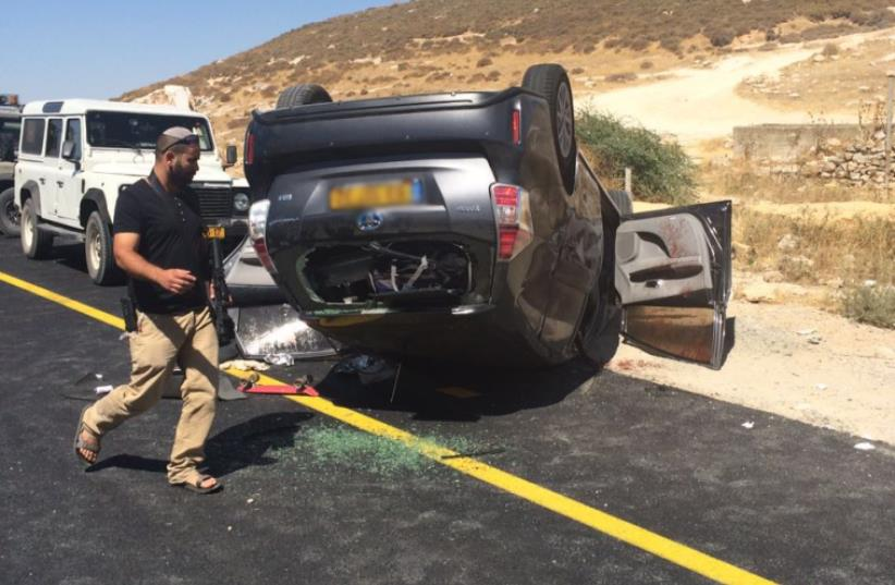 Shooting causes car to flip over on Route 60- July 1, 2016 (photo credit: FIRE AND RESCUE SERVICE)