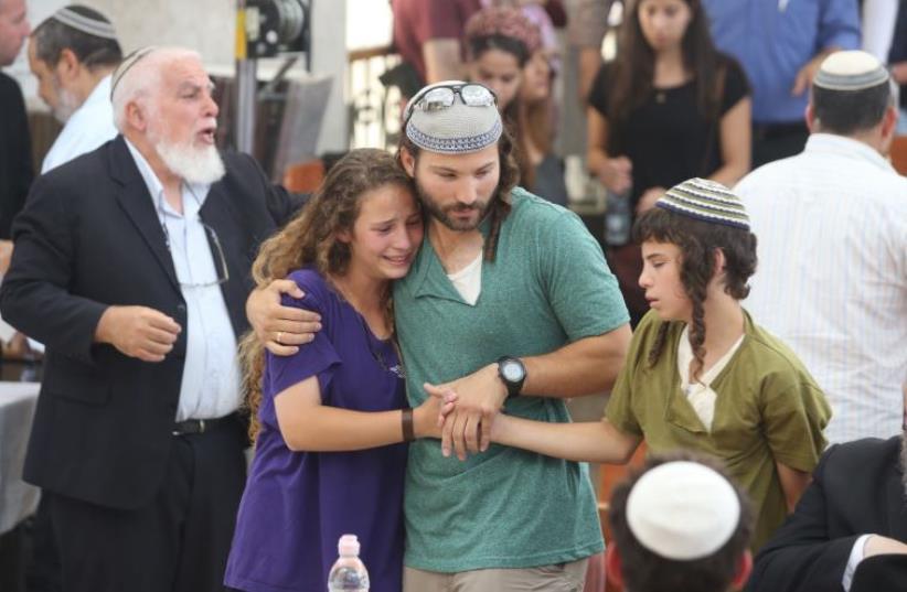 Family of Rabbi Michael Mark at his funeral in Jerusalem (photo credit: MARC ISRAEL SELLEM/THE JERUSALEM POST)