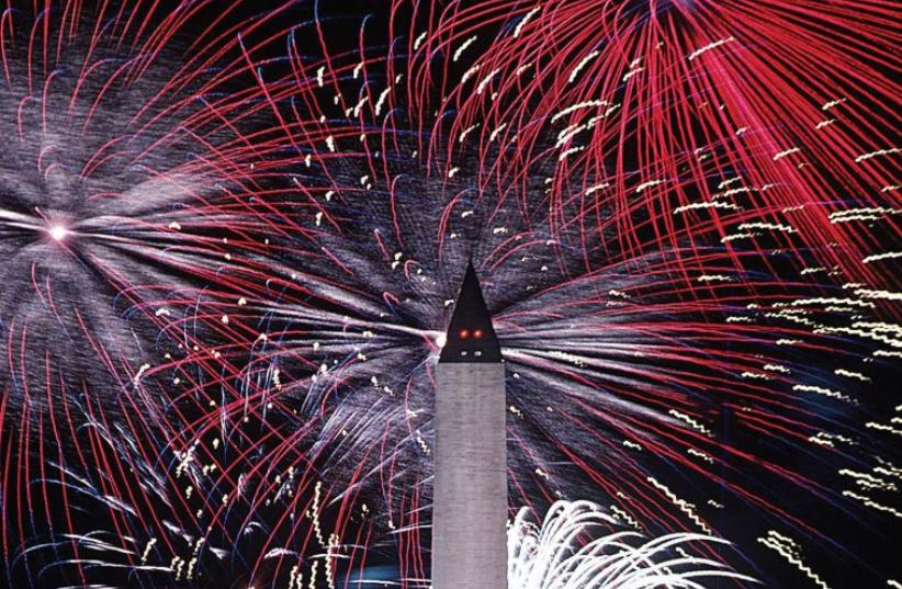 An American Independence Day fireworks display at the Washington Monument (photo credit: Wikimedia Commons)