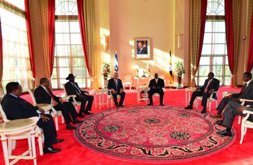 Prime Minister Benjamin Netanyahu with seven east African leaders (photo credit: KOBI GIDEON/GPO)