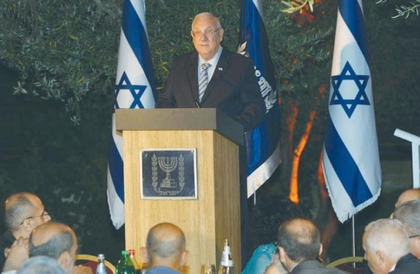 PRESIDENT REUVEN RIVLIN speaks at an Iftar meal on Sunday at the President's Residence in Jerusalem. ( (photo credit: AMOS BEN GERSHOM, GPO)
