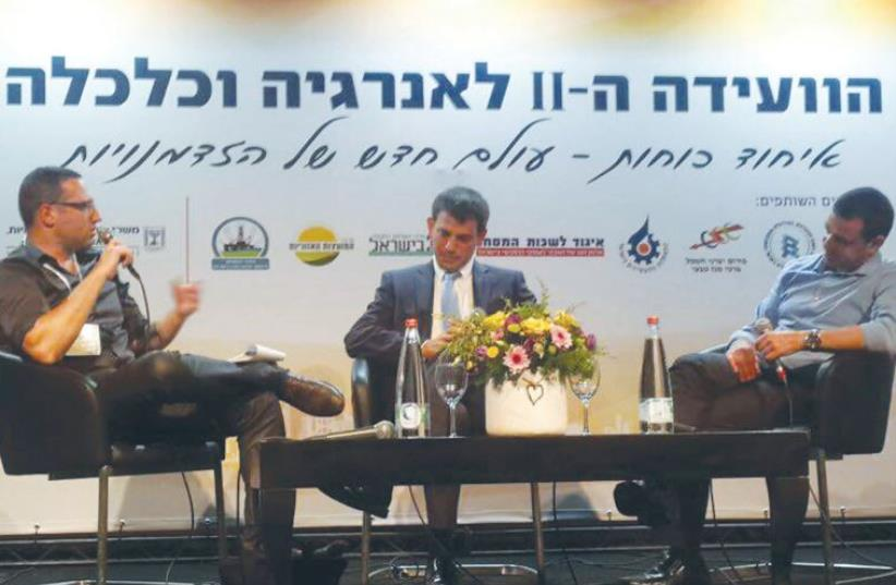AMIT LANG, director-general of the Economy Ministry (right), Shaul Meridor, directorgeneral of the National Infrastructure, Energy and Water Resources Ministry (center), and moderator Avi Bar-Eli of 'The Marker' speak at the conference yesterday (photo credit: EITAN PARNESS)