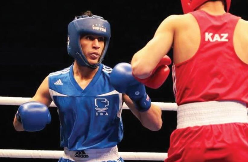 Teenager Ahmad Shtewe (in blue) is regarded as Israeli boxing's big hope and is aiming to become the first Arab to be part of an Israel delegation to the Olympics since 1976 at the Tokyo Games in four years' time. (photo credit: Courtesy)