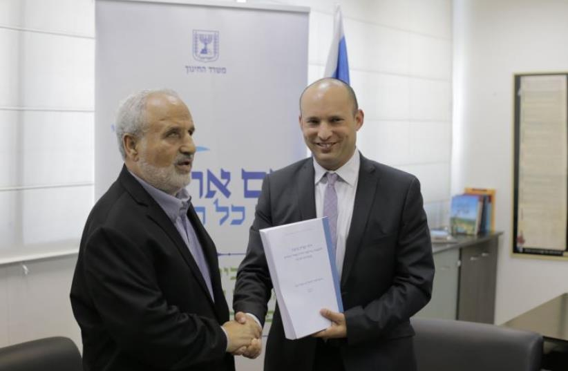 Erez Biton presents the recommendations of the Biton Committee to Education Minister Naftali Bennett in Tel Aviv on Thursday (photo credit: DANIEL BROWN)