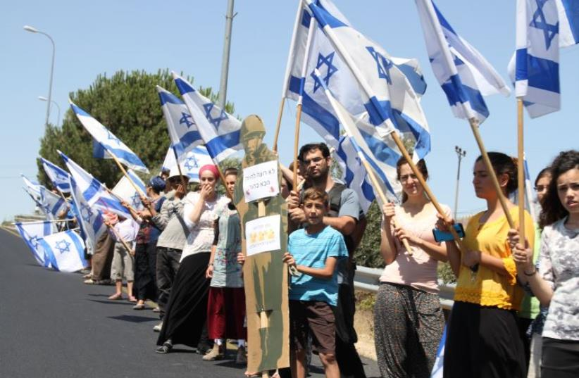Settlers protest dangerous West Bank Roads (photo credit: JACK BRADY)