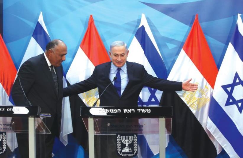 PRIME MINISTER Benjamin Netanyahu meets Egypt's Foreign Minister Sameh Shoukry in Jerusalem on Sunday (photo credit: MARC ISRAEL SELLEM/THE JERUSALEM POST)