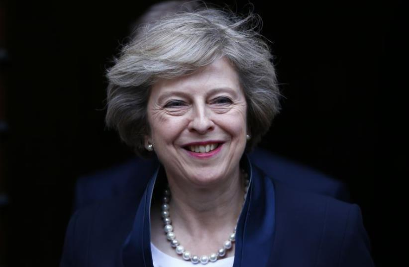 Theresa May emerges to speak to reporters after being confirmed as the leader of the Conservative Party.. (photo credit: REUTERS)