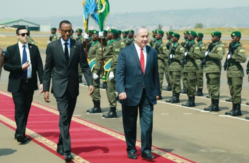 Prime Minister Benjamin Netanyahu walks alongside Rwandan President Paul Kagame in Kigali, Rwanda on July 6 (photo credit: REUTERS)