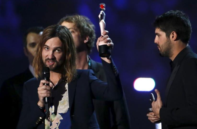 Kevin Parker of band Tame Impala speaks as they receive their Best International Group award at the BRIT Awards at the O2 arena in London, Britain, February 24, 2016 (photo credit: REUTERS)