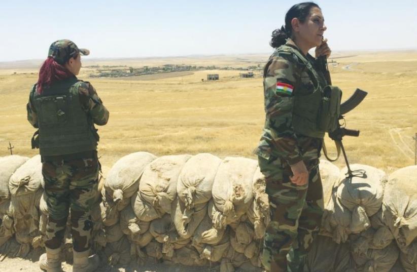 PESHMERGA FIGHTERS stand guard at a checkpoint near Mosul Dam on the Tigris River in Kurdistan.  (photo credit: SETH J. FRANTZMAN)