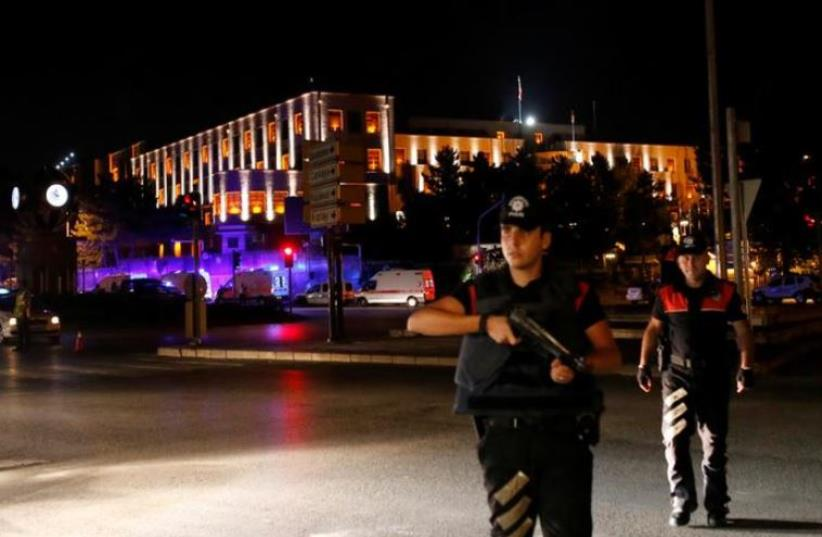 Police officers stand guard near the Turkish military headquarters in Ankara, Turke (photo credit: REUTERS)