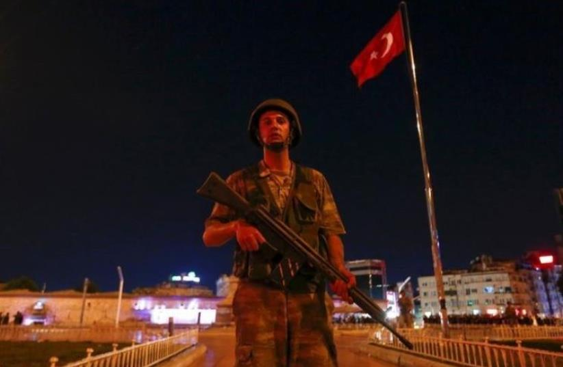 A Turkish military stands guard near the Taksim Square in Istanbul (photo credit: REUTERS)