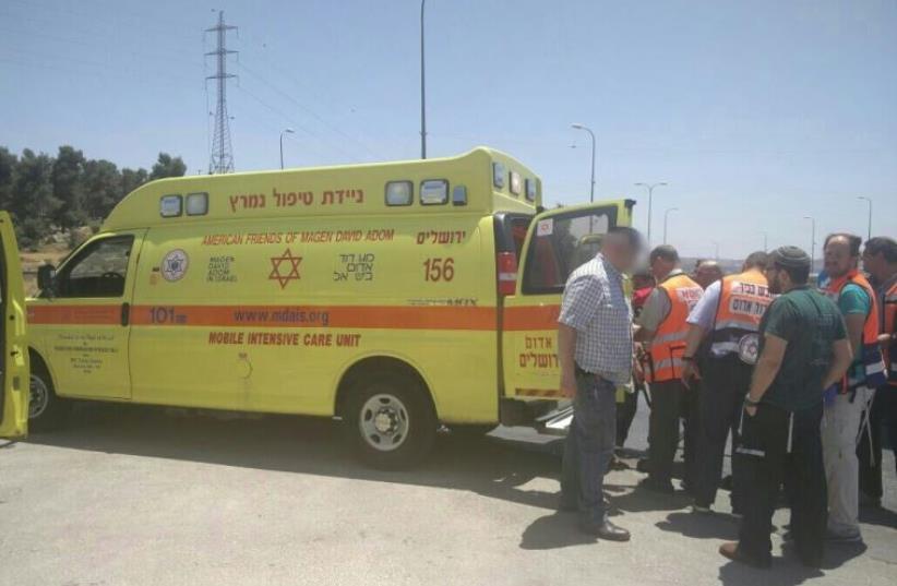 Ambulance at scene of stabbing attack in Gush Etzion, July 18, 2016 (photo credit: MAGEN DAVID ADOM)