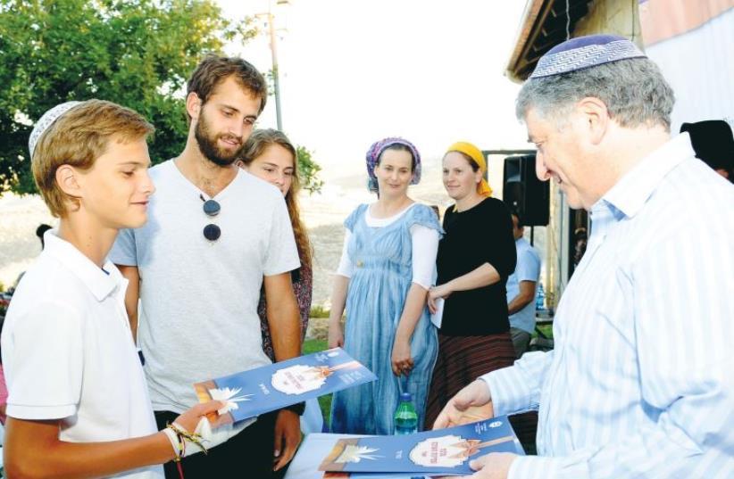 URIEL BLUM receives a scholarship at the Colel Chabad event on Monday. (photo credit: KOBI AMSALEM)