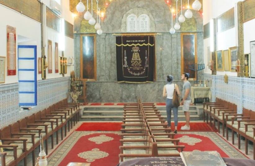 TOURISTS VISIT the Lazama Synagogue in Marrakesh, Morocco. (photo credit: KATI ROUMANI)