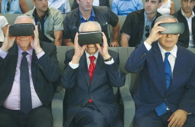 PRESIDENT REUVEN RIVLIN, former president Shimon Peres, and Prime Minister Benjamin Netanyahu don virtual reality goggles at the Peres Center for Peace and Innovation in Jaffa (photo credit: REUTERS)