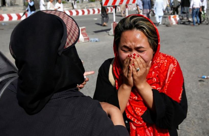 An Afghan woman weeps at the site of a suicide attack in Kabul, Afghanistan July 23, 2016 (photo credit: REUTERS)