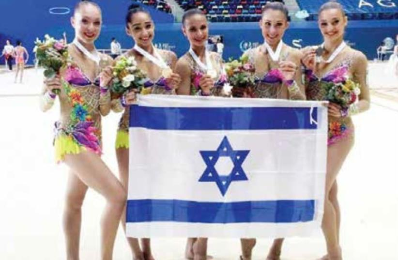 The members of Israel's rhythmic gymnastics national team pose with the gold medals they won yesterday in the ribbons final at the World Cup competition in Baku, Azerbaijan. (photo credit: (OLYMPICS COMMITTEE OF ISRAEL/COURTESY))
