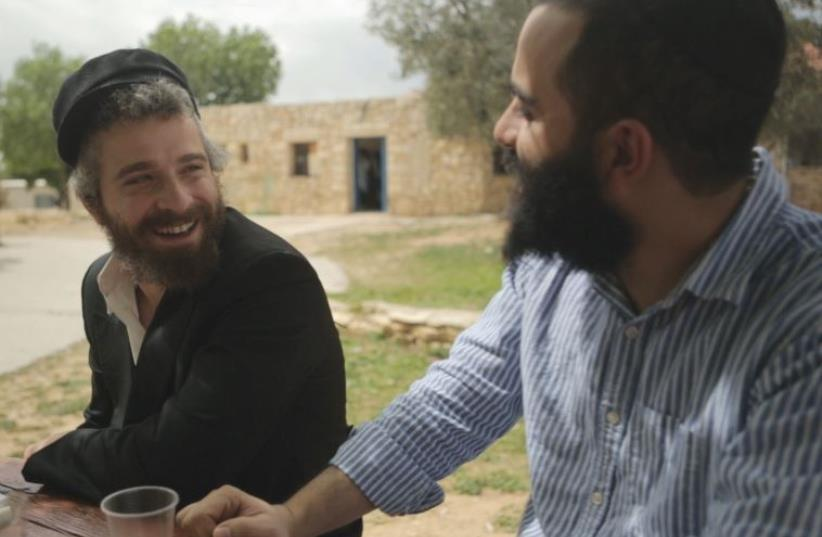 ELAD NEHORAI (right) speaks to a Bat Ayin resident in March. (photo credit: Courtesy)