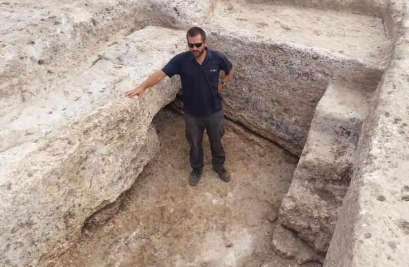 IAA excavation director Joppe Gosker inside the pottery workshop's water reservoir in Shlomi. (photo credit: COURTESY OF ROYEE LIRAN/ ISRAEL ANTIQUITIES AUTHORITY)